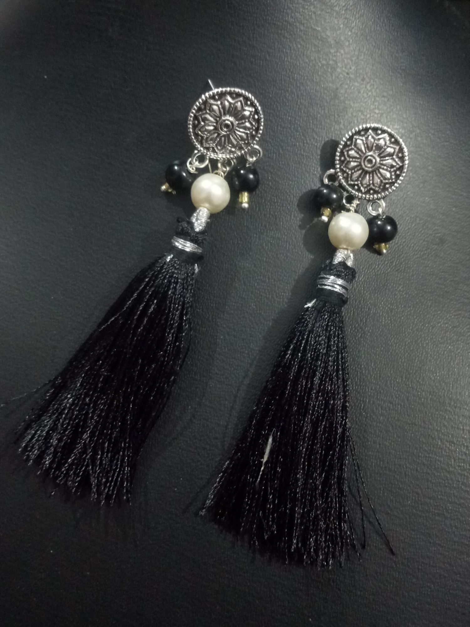 Pleasing Black Tussel Earrings